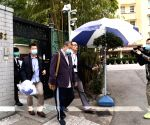 Hong Kong media tycoon held amid sweep of arrests