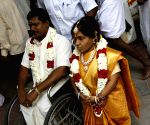 People with physical physical disabilities tie knots at mass marriage ceremony