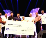 Kamal Haasan contributes on behalf of All India Malayalee Association