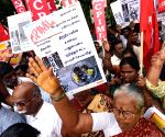 Members of Communist Party of India shout slogans against Obama's visit