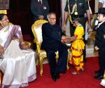 Schools childrens tie Rakhi on the wrist of Pranab Mukherjee at Rashtrapati Bhavan