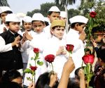 Photos of kids dressed up as Jawaharlal Nehru on Children's Day !!