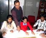 Guwahati Blind School demonstrating the use of Braille language during the 205th birthday of Lui Braille