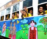 Children painting on a tram
