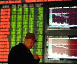 Chinese shares open higher, yuan weakens