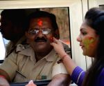 Citizens celebrate Holi with police officers