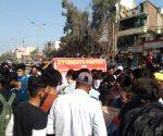 Free Photo: College students protest, block road, boycott classes demanding online examination