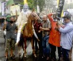 Kolkata : Congress activists with effigy of Prime Minister Narendra Modi on horseback take part in a rally to protest against fuel price hike in Kolkata
