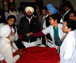 Congress leader Captain Amarinder Singh meeting with the patients who lost their eyesight