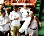Congress MLA in Karnataka removes his shirt inside Assembly.
