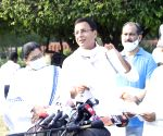 Randeep Singh Surjewala talks to the media outside Parliament
