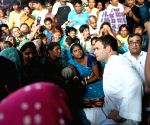Rahul Gandhi interacts with street vendors