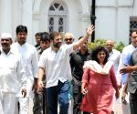 Rahul Gandhi waves at party workers