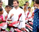 Rahul Gandhi and Priyanka Gandhi Vadra distributes keys of three-wheeler scooters