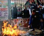Congress workers burn effigies of Arvind Kejriwal