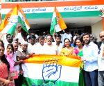 Congress-JD-S trounces BJP 4-1 in Karnataka by-elections - Congress workers celebrate