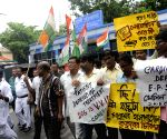 Congress demonstrate against the transfer of Pradip Mitra