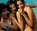 "Contestants pose for photographers during the swimwear round of ""Dabur Gulabari Sananda Tilottama"" on Wednesday in Vedic Village of Kolkata on 10 Jun 2009. Ten finalists were present for the swimsuit round."