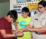 Children tie rakhis on Mumbai cops' wrists