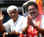 CPI(M) leader Sujan Chakraborty along with Sanjukta Morcha candidate of Dumdum constituency Palash Das at a road during the State Assembly election in Kolkata