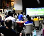 :Bengaluru:Cricket fans watch the World Cup T20 match of India and Pakistan, on a big screen,