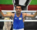 Boxer Deepak upsets Olympic champ to enter 52kg final