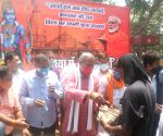 Adesh Gupta distributes face masks, sanitisers and earthen lamps on the eve of Ram Mandir Bhumi Pujan