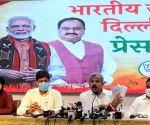 Delhi BJP President Adesh Gupta, LOP, Ramvir Singh Bidhuri and others address a press conference on an important issue at BJP Delhi Office in New Delhi