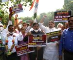 Congress protests against Modi and Kejriwal Govts over vegetable price hike