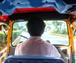 Free Photo:  Delhi first woman auto driver Sunita Choudhary.