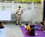 Delhi Police constable imparting education to slum kids