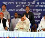 Mayawati, Akhilesh, Ajit denounce BJP, Congress