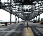 Deserted looks at the Howrah bridge during partial lockdown in Kolkata