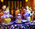 Devotees from the International Society of Krishna Consciousness (ISKCON) perform rituals during the Snana Yatra (Bathing ceremony) celebrations, in Kolkata.