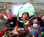 Devotees immerse an Idol of Goddess Durga at Patna Law College Ganga Ghat,