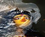 Kolkata :Devotees immerse an Idol of Goddess Durga on the bank of River Ganga