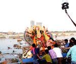 Devotees immerse Durga idols in Yamuna despite ban