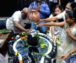 Devotees offer prayers at a Shiva temple