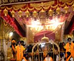 Devotees offer prayers at the Golden Temple on 551st birth anniversary of Guru Nanak Dev