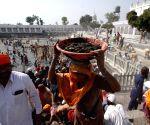 Devotees perform Kar Seva at Gurudwara Baba Budda Sahib