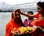 Devotees perform rituals during Chaiti Chhat puja festival in Kolkata on April 18, 2021.