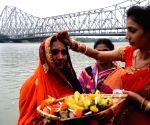 Devotees perform rituals during Chaiti Chhat puja festival in Kolkata on April 18, 2021.