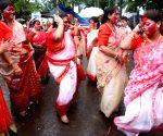 Kolkata :Devotees wear traditional Bengali Saree as they take part of Immersion procession of Goddess Durga in Kolkata .
