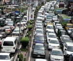 Vehicles are stuck in a traffic jam on a road in the rush hour during the Islamic holy month of Ramadan