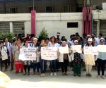 Medicos of ESI-PGIMSR Hospital protest against attack on doctors