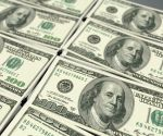 Dollar ticks up on rising risk aversion