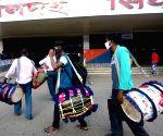 Kolkata :Drummers arrive Sealdah Station to return Home after end of Durga Puja Festival