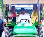 Riding tractor, Dushyant family reaches Haryana polling booth