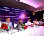 Election commission officials at a press conference