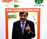 Delhi Polls 2020 - Election Commissioner Sushil Chandra casts vote